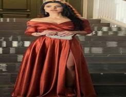 مصر اليوم - ماغي بو غصن تتألق في إطلالات أنثوية بقصّة الأوف شولدرز